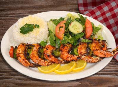 <h4>Grilled Shrimp Kabab </br> Pincho de Camarones Asados … $14.75</h4>