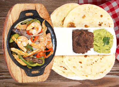 Grilled Chicken or Beef Fajitas - Fajitas de Res o Pollo… $15.00 - with shrimp / con camarones … $18.00